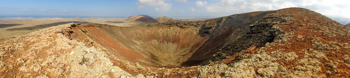 Vulcan Calderon Hondo in Fuerteventura, Spain. Crater of famous volcano Calderon Hondo on the Canary Island Fuerteventura, Spain. Panorama stock photography