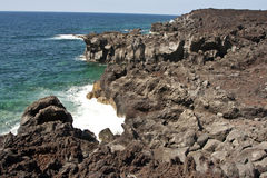 Vulcanic landscape. Vulcanic coastline in Lanzarote with blue ocean Stock Photo
