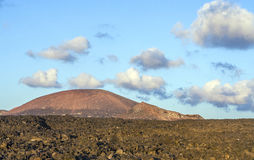 Vulcanic landscape under. The extincted vulcano in Timanfaya National Park Royalty Free Stock Photography