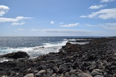 Stones and coast of Fuerteventura, Canary Island. Vulcanic stones on coast and sea waves on Fuerteventura island, near Caleta de Fuste. Canary Island stock photo