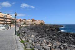 Promenade and coast of Fuerteventura, Canary Island. Vulcanic stones on coast and sea waves on Fuerteventura island, near Caleta de Fuste. Canary Island royalty free stock photo