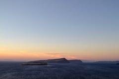 Vulcano al tramonto in Santorini Immagine Stock