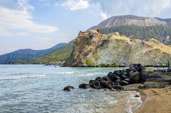 Vulcano island beach in Aeolian Islands. Beach of the island of vulcano with its volcanic rocks and rock formations of colored by the minerals Royalty Free Stock Photography