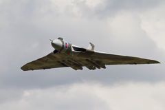 Vulcans last flight. HEADCORN, UK - AUGUST 15: A vintage Avro Vulcan bomber passes down the flight line at Headcorn aerodrome for the public to watch on August Stock Images