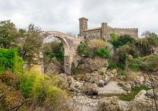 Vulci, Italy - Archeological etruscan park with medieval castle stock photography