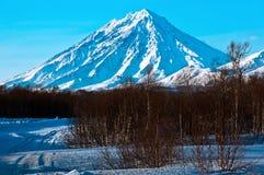 Vulkan abgedeckt mit Schnee Stockbild