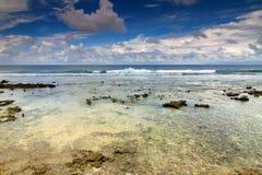 vulkanisk strandrock Arkivfoto