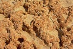 Vulkaniskt vagga yttersida på en strand i Portalegre, Portugal Arkivfoton