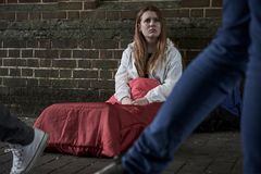 Free Vulnerable Homeless Teenage Girl Sleeping On The Street Royalty Free Stock Images - 151502359