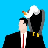 Vulture and businessman. neophron sitting on man shoulder Royalty Free Stock Image