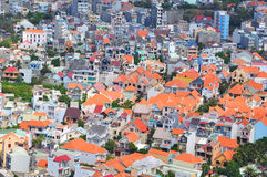 Little houses crammed in a big city in Asia Stock Images