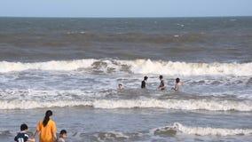 Vung Tau, Vietnam - January 26, 2018: Local residents bathe in the sea in clothes. Vung Tau, Vietnam - January 26, 2018: Local residents bathe in the sea in stock footage