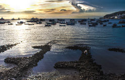 Vungtau sunset. Afternoon in Vung Tau with fishermen, boat and sea Stock Photo