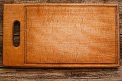 Vuoto posto piano marrone vuoto del tagliere Fotografia Stock