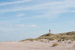 Vuurtoren bij een strand op sylteiland Stock Foto's