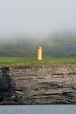 Vuurtoren in de mist Stock Foto's