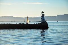 Vuurtoren en een boot Stock Fotografie