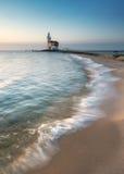 Vuurtoren en strand Stock Afbeelding