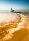 Vuurtoren en strand Royalty-vrije Stock Afbeeldingen