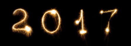 Vuurwerksterretje heldere het gloeien nieuwe de doopvont van de jarenvooravond het van letters voorzien aantaldatum Stock Afbeeldingen