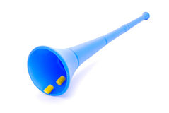 Vuvuzela with earplugs. A traditional real blue noisy plastic Vuvuzela instrument from South Africa used by soccer fans to support their teams in the soccer Stock Image