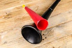Vuvuzela for football fans. Noisy soccer fan equipment vuvuzela royalty free stock photos
