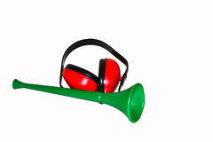 Vuvuzela with headphone. In front of withe background Stock Images