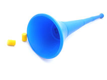 Vuvuzela horn and earplugs. Closeup of traditional blue South African Vuvuzela blowing horn used by soccer fans with two earplugs, isolated on white background Stock Photography