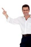 Vuxen attraktiv le man som pekar hans finger på copyspacen Arkivbilder