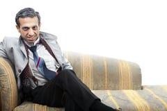 Gamal manförklädnad på sofaen Royaltyfria Foton