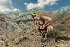 Vuxen naken man som cyklar på barns cykel Royaltyfri Fotografi