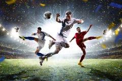 Vuxna fotbollspelare för collage i handling på stadionpanorama royaltyfria foton