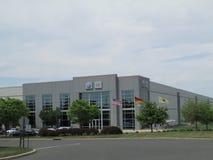 VW Audi Distribution Center de VAG dans NJ Drapeaux des Etats-Unis, de l'Allemagne et de l'état de New Jersey Photo libre de droits
