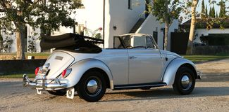 1964 VW Beetle. Classic convertible that became a darling of the youth of the 1960s. Cheap and sporty, the `64 Beetle had a 1,200cc engine capable of producing Royalty Free Stock Photography