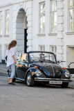 Vw beetle an old antique restorated automobile is on the street. Stock Photos
