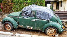 Old volkswagen beetle rusting on street royalty free stock images