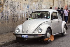 VW Beetle with Wheel Clamps in La Paz, Bolivia Stock Images
