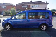 VW Caddy. Blue car parked on the road Royalty Free Stock Image