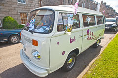 VW camper van with elevating roof. VW motorhome with pop-up roof and decorated with flowers and snow flakes on show at Motormania  held at Grantown-on-Spey on Royalty Free Stock Photography