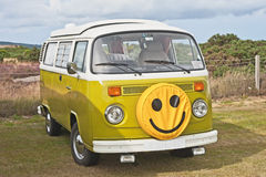 VW caravanette with smiley face. Rear engined VW autosleeper with smiley face, elevating roof and slatted windows royalty free stock photography