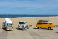 VW kombi vans at the beach Royalty Free Stock Photo
