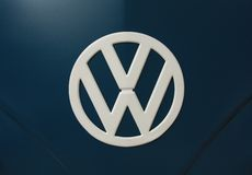 VW Logo. A white VW logo on a blue car Stock Images