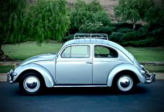 1956 VW Oval Window Beetle. The iconic VW Oval Window Bug is one of the most cherished for its simplicity. Classic lines and beautifully detailed trim and Royalty Free Stock Photos