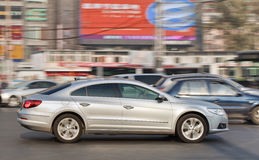 VW Passat CC in busy city center, Beijing, China royalty free stock photography