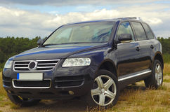 Vw touareg. Black new vw touareg v10 on a hill from the front stock image