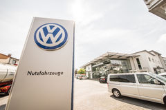 VW utility vehicles. Sign infront of an Volkswagen dealership with utility vehicles stock photography
