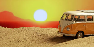 VW van on the beach at sunset. Copy space Stock Images