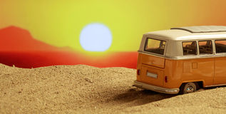 VW van on the beach at sunset stock images