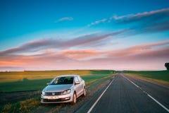 VW Volkswagen Polo Vento Sedan Car Parking Near Asphalt Country Stock Image