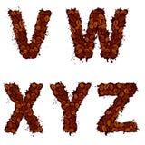 VWXYZ, Buchstaben des englischen Alphabetes, gemacht von den Kaffeebohnen, im Schmutz Lizenzfreie Stockfotografie